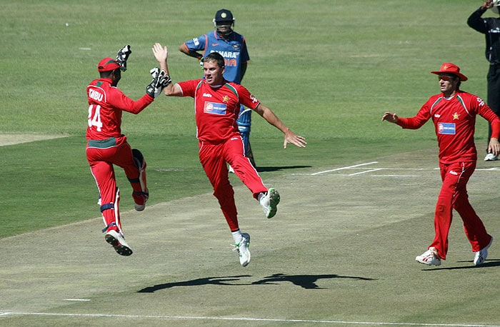 Zimbabwean wicketkeeper Tatenda Taibu and bowler Raymond Price celebrate after taking the wicket of Yusuf Pathan at Harare Sports Club during the fourth ODI of the tri-series. (AFP Photo)