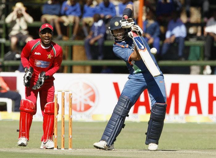 Indian batman Virat Kohli blocks the ball in the watchful eyes of Zimbabwean wicketkeeper Tatenda Taibu at Harare Sports Club during the fourth ODI of the tri-series. (AFP Photo)