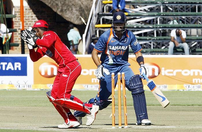 Zimbabwean wicketkeeper Tatenda Taibu stumps Indian batsman Murali Vijay at Harare Sports Club during the fourth ODI of the tri-series. (AFP Photo)