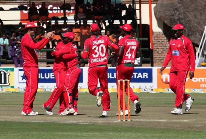 Zimbabwean players celebrate the wicket of Indian batsman Dinesh Karthik at the Harare Sports Club during the fourth ODI of the tri-series. (AP Photo)