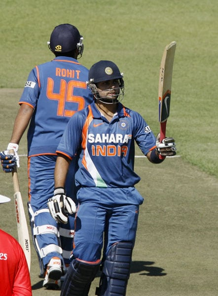 Indian batsman Virat Kohli raises the bat after his half-century in the fifth ODI of the Micromax Cup Triangular Series in Harare. (AFP Photo)