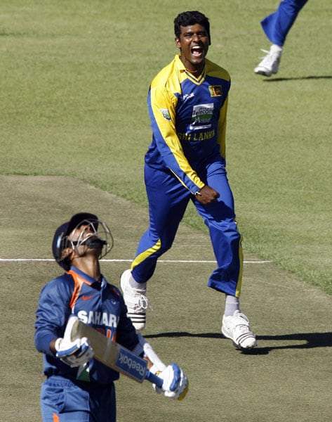 Sri Lankan bowler Thissara Perera celebrates after he took the wicket of Indian batsman Dinesh Karthik in the fifth ODI of the Micromax Cup Triangular Series in Harare. (AFP Photo)