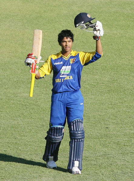 Sri Lankan batsman Dinesh Chandimal celebrates after reaching a century against India in the fifth ODI of the Micromax Cup Triangular Series in Harare. (AFP Photo)