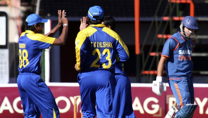 Sri Lanka players react after the wicket of India batsman Naman Ojha in the fifth ODI of the Micromax Cup Triangular Series in Harare. (AP Photo)