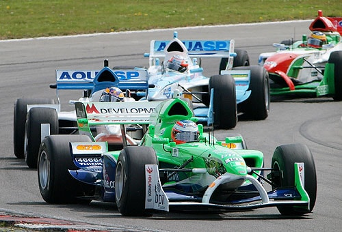 Ireland's Adam Carroll leads Switzerland's Neel Jani, India's Narain Karthikeyan, and Portugal's Filipe Albuquerque, right, to finish third in the first race at Brands Hatch, South of London on May 4, 2008. (AP Photo)
