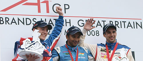 India's Narain Karthikeyan celebrates winning the second race of the A1GP, with Great Britain's Robbie Kerr (left) who finished second, and Switzerland's Neel Jani (right) who finished third, in the race at Brands Hatch, South of London on May 4, 2008. (AP Photo)