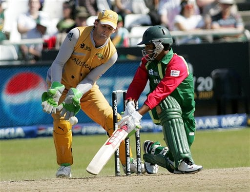 Bangladesh's Tamim Iqbal Khan sweeps the ball as Australia's wicket keeper Adam Gilchrist looks on during World Twenty 20 cricket Championships at Newlands in Cape Town, South Africa, Sunday, Sep. 16, 2007.