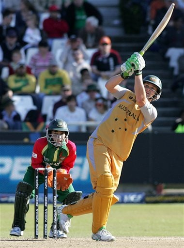 Australia's Adam Gilchrist, right, eyes the ball during the Twenty20 World Championship cricket match against Bangladesh at Newlands in Cape Town, South Africa, Sunday, Sept. 16, 2007.