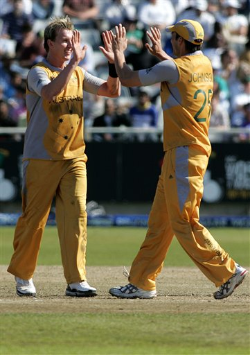Australia's Brett Lee, left, celebrates with his teammate Mitchell Johnson, right, after dismissing Bangladesh's Alok Kapali, during World Twenty 20 cricket Championships at Newlands in Cape Town, South Africa, Sunday, Sept. 16, 2007.