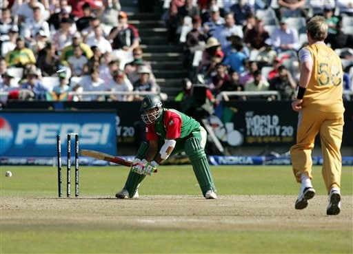 Bangladesh's Alok Kapali reacts after he was dismissed by Australia's Brett Lee, right, during World Twenty 20 cricket Championships at Newlands in Cape Town, South Africa, Sunday, Sept. 16, 2007.