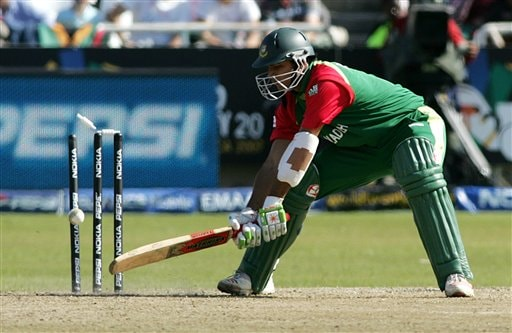 Bangladesh's Alok Kapali eyes his ball after he was dismissed by a bowling from Australia's Brett Lee, not pictured, during their World Twenty20 cricket Championships at Newlands in Cape Town, South Africa, Sunday, Sep. 16, 2007.