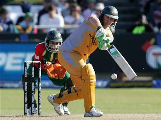 Australia's Adam Gilchrist, right, plays a stroke during the Twenty20 World Championship cricket match against Bangladesh at Newlands in Cape Town, South Africa, Sunday, Sept. 16, 2007.