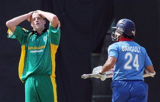 Africa XI's Morne Morkel, left, reacts after Asia XI's Sourav Ganguly hit a boundary on his delivery during the first One-Day International Afro-Asian cricket match in Bangalore, India on Wednesday.