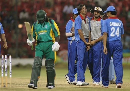 Asia XI's Mohammad Asif, third right, celebrate with teammates after dismissing Africa XI's Steve Tikolo, left, during the first One-Day International Afro-Asian cricket match in Bangalore, India on Wednesday.