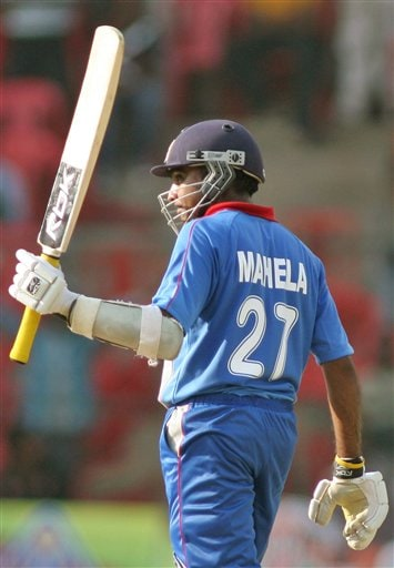 Asia XI's cricket Captain Mahela Jayawardene raises his bat after completing a half century during the first One-Day International Afro-Asian cricket match against Africa XI, in Bangalore, India on Wednesday.