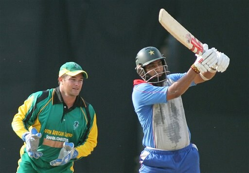 Asia XI's Mohammad Yousuf, right, hits a boundary as Africa XI's wicket keeper Mark Boucher looks on during the first One-Day International Afro-Asian cricket match in Bangalore, India on Wednesday.