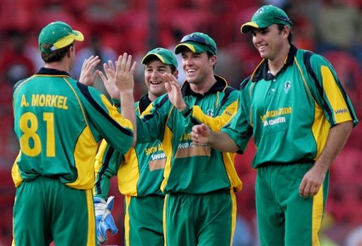 Africa XI cricketers, from left to right, A Morkel, Mark Boucher, AB De Villiers and Justin Kemp celebrate the dismissal of Asia XI's Yuvraj Singh, unseen, during the first One-Day International Afro-Asian cricket match in Bangalore, India on Wednesday.