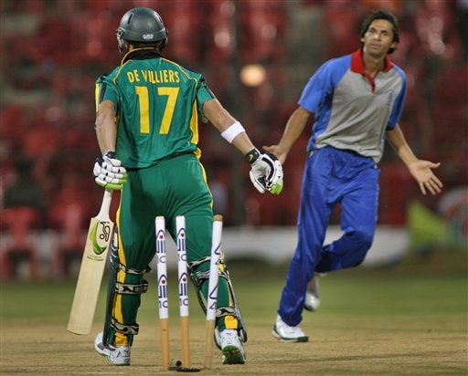 Asia XI's Mohammad Asif, right, reacts after bowling out Africa XI's AB De Villiers, left, during the first One-Day International Afro-Asian cricket match in Bangalore, India on Wednesday.