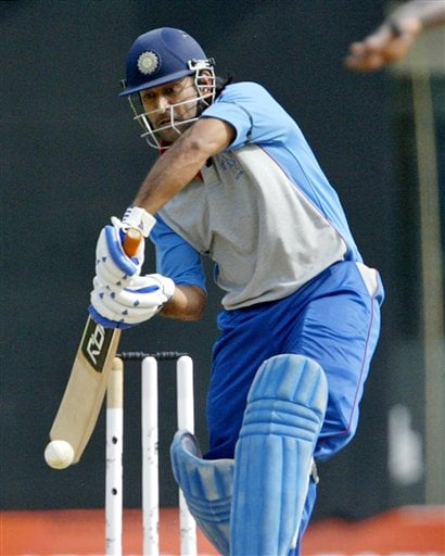 Asia XI player Mahendra Dhoni bats during the second One-Day international Afro-Asia cricket match against Africa XI, in Chennai, India, Saturday, June 9, 2007.