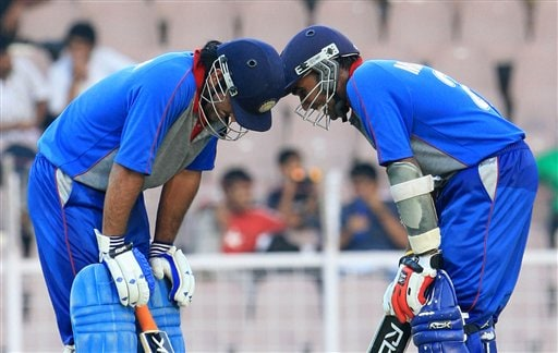 Asia XI skipper Mahela Jayawardene, right and player Mahendra Dhoni share a moment during their batting partnership against Africa XI during the third and final One-Day cricket match of the Afro-Asia Cup in Chennai, India, Sunday, June 10, 2007. Dhoni and Jayawardene posted aggressive centuries to lift Asia XI to 331 for eight after a top-order slump on Sunday.