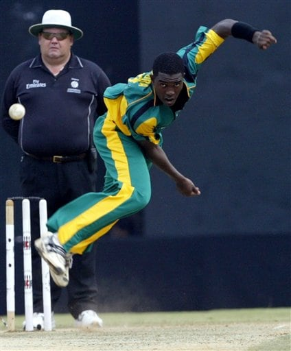 Africa XI's Elton Chigumbura bowls against Asia XI during the third and final One-Day cricket match of the Afro-Asia Cup in Chennai, India, Sunday, June 10, 2007.