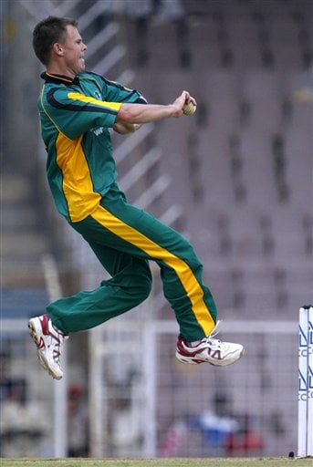 Africa XI's Johan Botha bowls against Asia XI during the third and final One-Day cricket match of the Afro-Asia Cup in Chennai, India, Sunday, June 10, 2007.