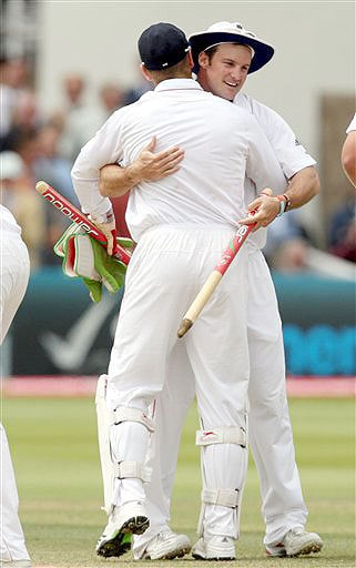 England captain Andrew Strauss embraces Matt Prior after their 115 run victory over Australia on the fifth day of the second Ashes Test at Lord's cricket ground in London on Monday. (AP Photo)