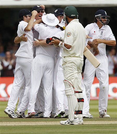 England players celebrate as Australia's Ben Hilfenhaus looks on after England bowled out Australia on the fifth day of the second Ashes Test at Lord's cricket ground in London on Monday. (AP Photo)