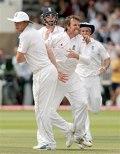England's Graeme Swann celebrates after claiming the wicket of Australia's Mitchell Johnson during the fifth day of the second Ashes Test at Lord's cricket ground in London on Monday. (AP Photo)