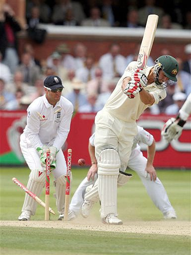 Australia's Mitchell Johnson is bowled out by England's Graeme Swann during the fifth day of the second Ashes Test at Lord's cricket ground in London on Monday. (AP Photo)