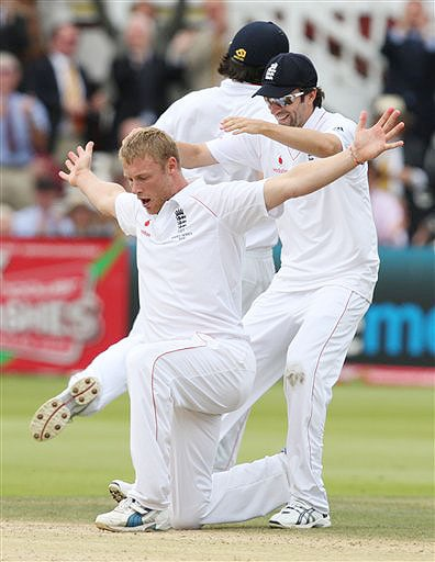 England's Andrew Flintoff, kneeling, claims the wicket of Australia's Peter Siddle during the fifth day of the second Ashes Test at Lord's cricket ground in London on Monday. (AP Photo)