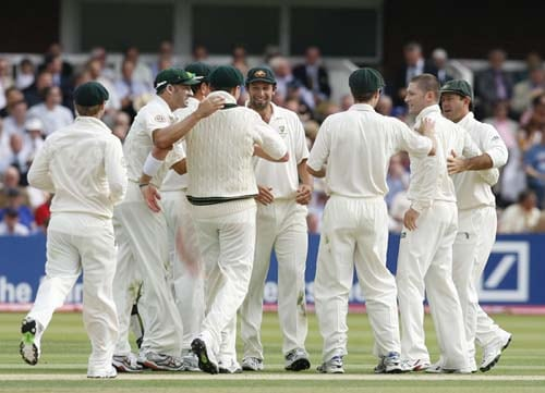 Michael Clarke is congratulated by Ricky Ponting on taking the wicket of Paul Collingwood caught by Peter Siddle during the first day of the second Ashes Test at Lord's. (AFP Photo)