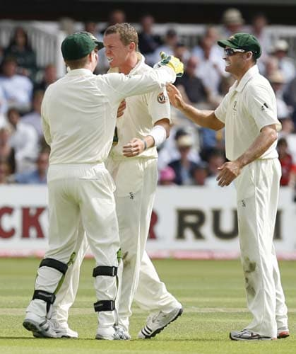 Peter Siddle celebrates the wicket of Kevin Pietersen caught by Brad Haddin during the first day of the second Ashes Test at Lord's. (AFP Photo)