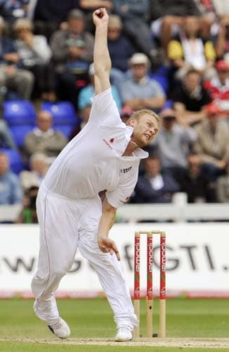 Andrew Flintoff sends down a delivery to an Australian batsman during the second day of the first Ashes Test in Cardiff. (AFP Photo)