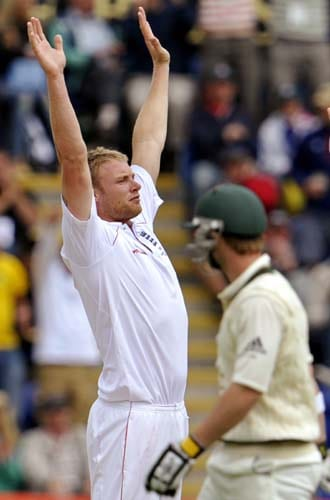 Andrew Flintoff celebrates after dismissing Phil Hughes during the second day of the first Ashes Test in Cardiff. (AFP Photo)