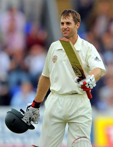 Simon Katich celebrates after reaching his century during the second day of the first Ashes Test in Cardiff. (AFP Photo)