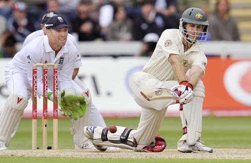 Simon Katich sweeps a ball as Matt Prior looks on during the second day of the first Ashes Test match in Cardiff. (AFP Photo)