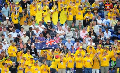 Australian fans celebrate runs scored by their team against England during the second day of the first Ashes Test in Cardiff. (AFP Photo)