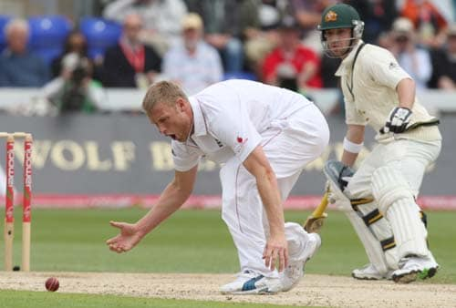 England's Andrew Flintoff reacts after narrowly missing a chance to catch out Simon Kaitch during the second day of the first Ashes Test in Cardiff. (AP Photo)