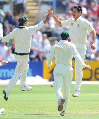 Mitchell Johnson celebrates after taking the wicket of Andrew Flintoff on the final day of the first Ashes Test in Cardiff. (AFP Photo)