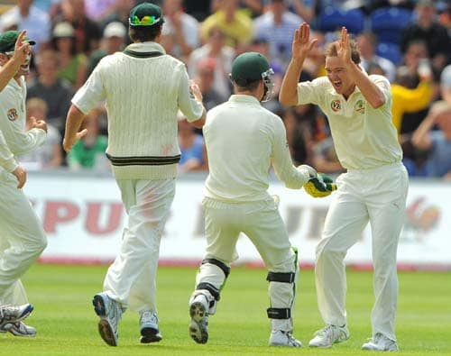 Nathan Haueitz celebrates after taking the wicket of Matt Prior on the final day of the first Ashes Test in Cardiff. (AFP Photo)