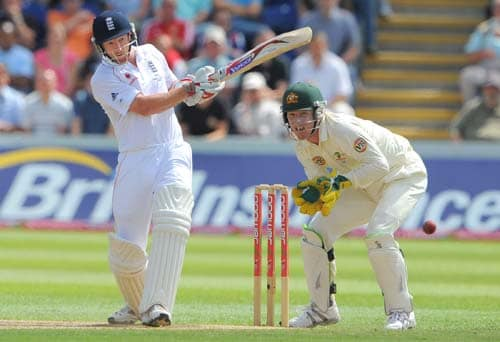 Paul Collingwood bats Brad Haddin looks on, on the final day of the first Ashes Test in Cardiff. (AFP Photo)