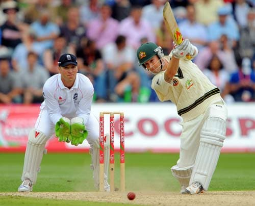Michael Clarke bats as Matt Prior looks on, on the third day of the first Ashes Test in Cardiff. (AFP Photo)