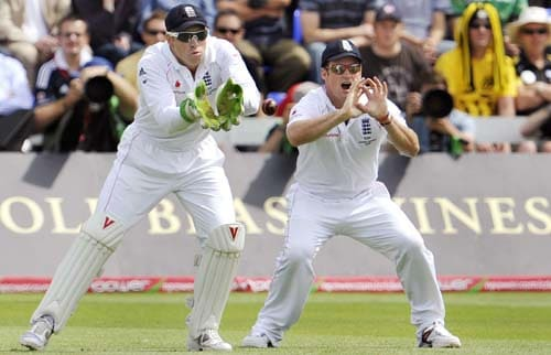 Matt Prior and Andrew Strauss react after the ball beats the bat on the third day of the first Ashes Test in Cardiff. (AFP Photo)