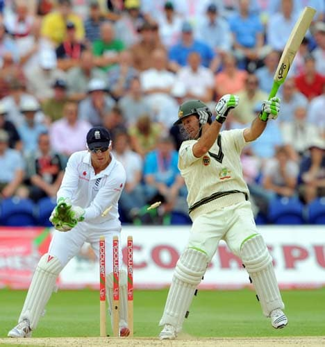 Ricky Ponting is bowled out by Monty Panesar watched by Matt Prior on the third day of the first Ashes Test in Cardiff. (AFP Photo)