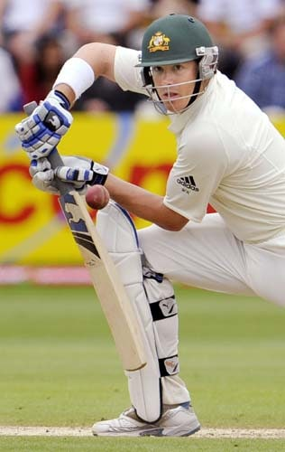 Marcus North steers a ball away from the England attack on the fourth day of the first Ashes Test in Cardiff. (AFP Photo)