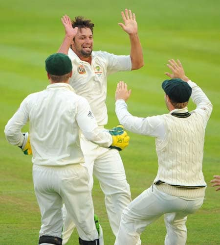 Ben Hilfenhaus celebrates after taking the wicket of Ravi Bopara on the fourth day of the first Ashes Test in Cardiff. (AFP Photo)