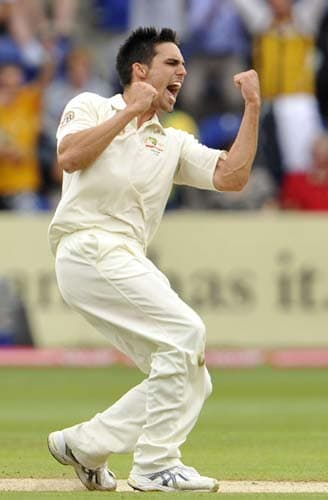 Mitchell Johnson celebrates dismissing Alastair Cook on the fourth day of the first Ashes Test in Cardiff. (AFP Photo)