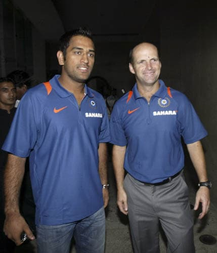 India captain M.S. Dhoni and coach Gary Kirsten address the media before leaving for the Asia Cup in Pakistan.