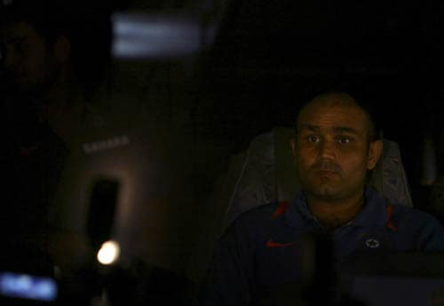 Virender Sehwag leaves the team hotel in Mumbai before the team's departure to play the Asia Cup in Pakistan.